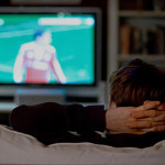 man watching tv rather than risking desire